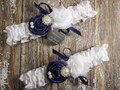 Personalized White Satin Wedding Garter Set Shown with Regal Purple Roses and Bows