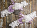 Personalized White Satin Wedding Garter Set Shown with Lavender Roses and Bows