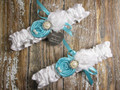 Personalized White Satin Wedding Garter Set Shown with Robin's Egg Blue Roses and Bows