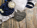 Engraving Detail on the White Satin Wedding Garter Shown with a Navy Blue Rose