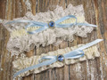 The Ivory Wedding Garter Set with a Gorgeous Blue Crystal