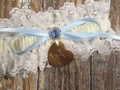 Engraving on the Personalized Ivory Lace Wedding Garter with a Blue Crystal