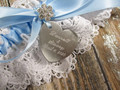 Details of the Engraving on the Personalized White and Blue Wedding Garter