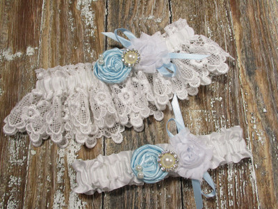 White Lace Wedding Garter Set Shown with Light Blue Roses