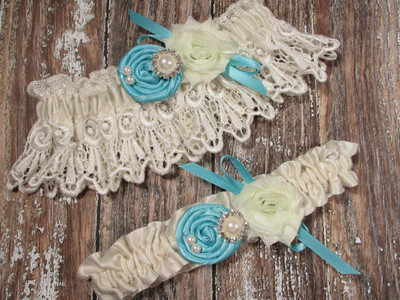 Ivory Lace Wedding Garter Set Shown with Robin's Egg Blue Roses