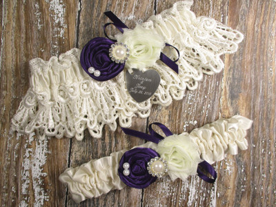 Personalized Ivory Lace Wedding Garter Set Shown with Purple Roses