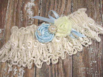 Ivory Lace Wedding Garter, Shown with a Light Blue Rose and Bow