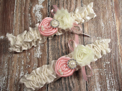 Ivory Satin Wedding Garter Set Shown with Pink Roses