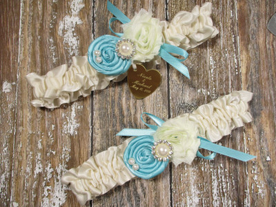 Personalized Ivory Wedding Garter Set in Satin Shown with Robin's Egg Blue Roses and Bows