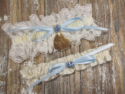 Personalized Ivory Wedding Garter Set with a Gorgeous Blue Crystal
