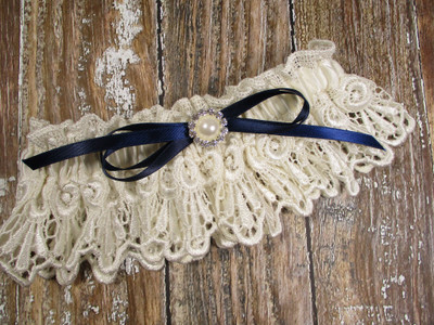 Ivory Lace Wedding Garter with Pearls and Rhinestones, Shown with a Navy Blue Bow