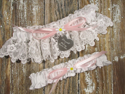 Personalized Daisy Wedding Garter Set Shown with a Pink Bow