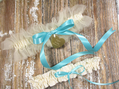 Personalized Ivory Wedding Garter Set Shown with Robin's Egg Blue Bows