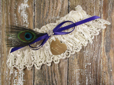 Personalized Ivory Lace Wedding Garter with a Peacock Feather, Shown with a Regal Purple Bow