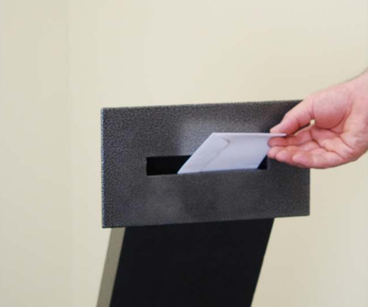 Envelope Drop Through Wall with Electronic Keypad Access envelope being dropped