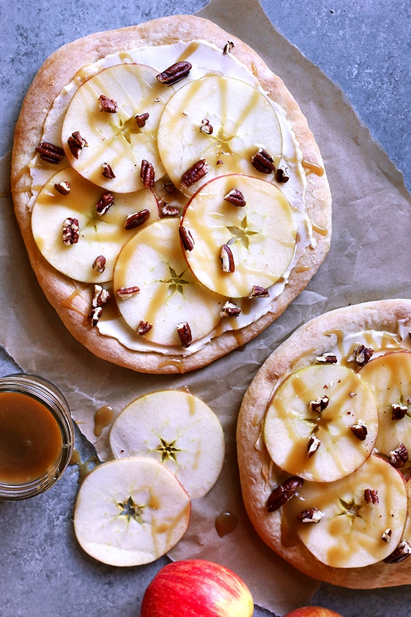 A dessert pizza topped with apple, Carmel and pecans.