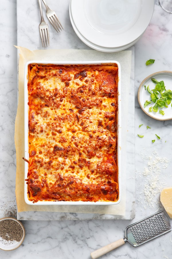 The lasagna is in the baking dish ready to be cut and served.