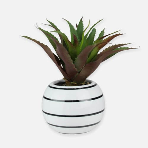 Artificial plant in white pot