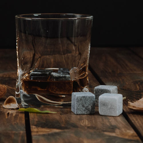 Glass of liquor &amp chilling cubes