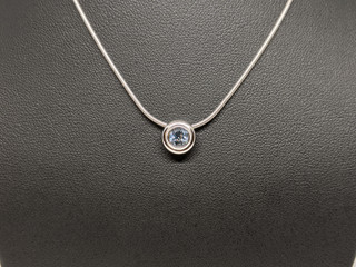 18ct White gold rub over set aqua pendant