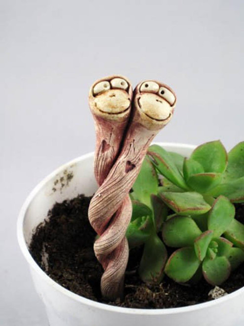"Double Tiny Worm Planter Creeps Height:  4.5"" Width:  1"" Hand sculpted individually, highly textured, stained with iron oxide, glazed and high fired to cone 6, so they do well indoors or out.  Brushed for texture and comes with sharp end to insert into soil, intertwined and creeping out of your plants in natural earth tones as pictured."