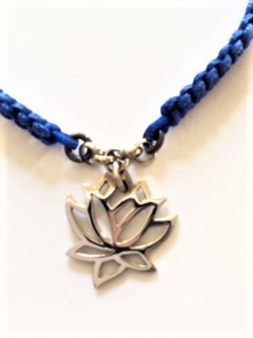 "Macramé royal blue cotton cord bracelet with attached sterling silver lotus cutout charm  Macramé width:  .18"" Lotus charm is .68"" Bracelet is adjustable using macramé slide Slide ends are finished with coordinating sterling silver bead By Athena Designs"