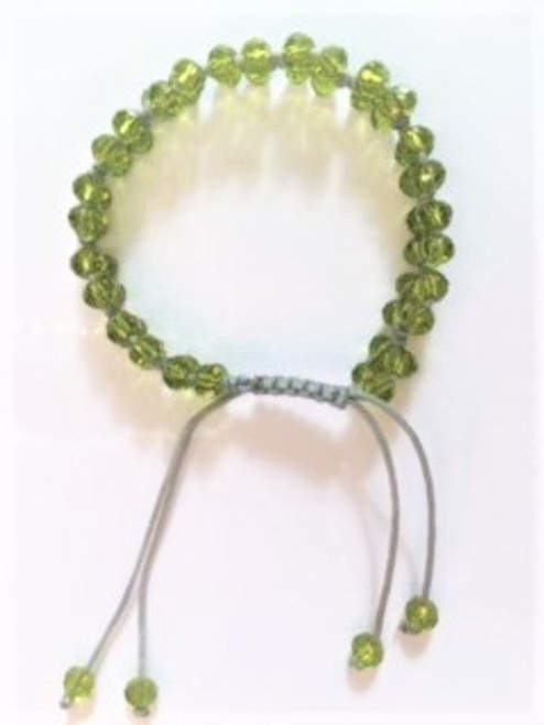 "Macramé with light gray cotton cord and peridot colored faceted crystal beads used with a four bead pattern between macramé knots Bracelet width:  .43"" Bracelet is adjustable using macramé slide Slide ends are finished with coordinating bead By Athena Designs"