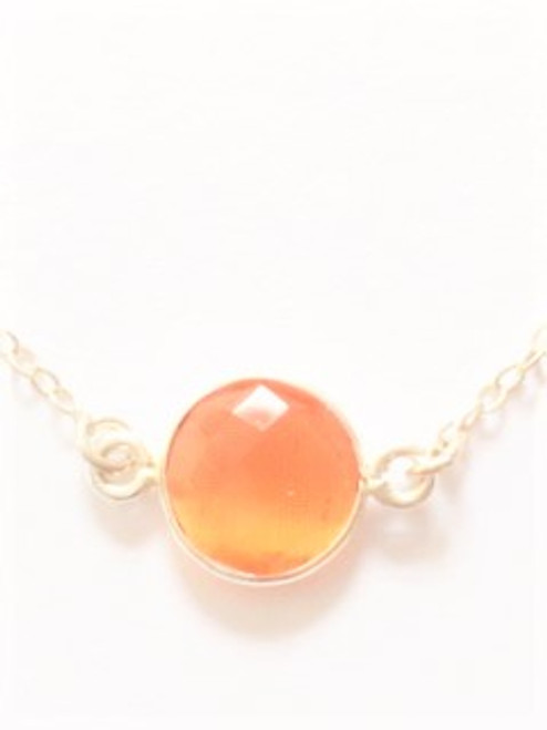 "Sterling silver fine chain bracelet 6.5"" in length Additional 1.5"" attached extender One flat coin bezel carnelian is .37"" diameter with shallow facets By Athena Designs"