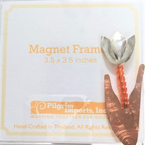 "Clear acrylic 3.5"" x 3.5"" magnet picture frame  Metal ""spring tulip"" motif is affixed to bottom right corner.  Metal is composed of three different metals—nickel, copper, and brass. There is no lead or any other harmful substance in the metals; all metal pieces are designed to be safe as possible, with a minimum of sharp corners and edges. Only lead free solder is used"