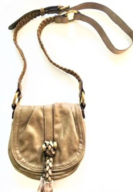 "Handbag size:  8"" wide; 7"" tall, 2"" depth  Polyurethane construction (PU) Front flap closure with snap Front flap has braided detail, faux suede tassel & bronze finding  Lining made of solid eggplant polyester Inside zip pocket 24"" drop adjustable strap with braided detail & bronze grommet findings By Shiraleah Fashion Accessories"