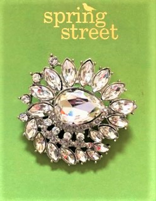 """Regal looking brooch is 1.75"""" in diameter Cast silver metal findings Clear crystals throughout design Lock back safety clasp fastener By Spring Street Design Group"""