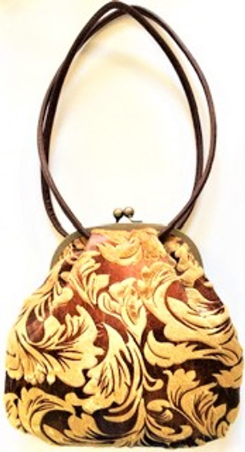 """Handbag size: 10"""" wide; 9"""" tall Rich camel burnout velvet with burgundy background fabric Large ball snap top closure Brown abstract satin pattern inside lining  Zip inside pocket Two soft fabric handles with 11"""" drop By Liz Soto Handbags"""