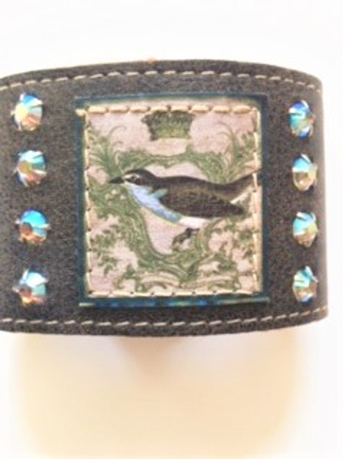 """Soft brown leather 2"""" cuff bracelet with two dual adjustable snap fasteners for 7"""" or 7.5"""" sizing L514 Royal Robin artwork stamped on leather & sewn to bracelet leather  Four aurora borealis iridescent Swarovski crystals on each side of robin artwork Handmade in Los Angeles by KBD Design"""