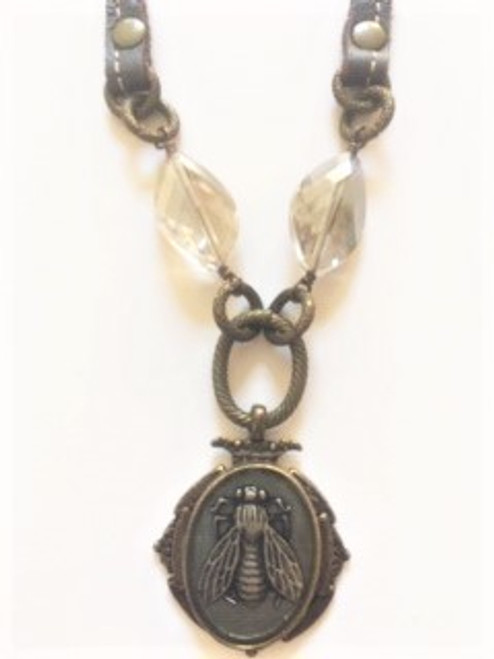 """Soft pewter leather 38"""" long continuous loop neck chain (no fastener)  HA02 bee artwork encased in bronze decorative medallion with clear resin on top  Two smoke colored glass beveled beads above bee medallion & wire wrap findings  Handmade in Los Angeles by KBD Design"""