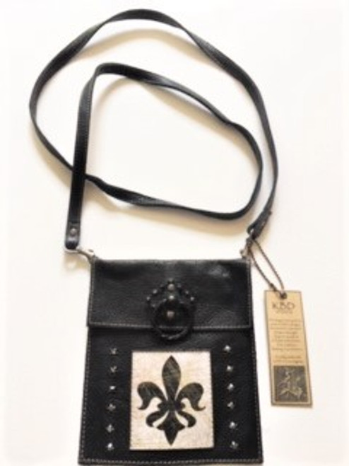 "Soft black pebble grain leather knocker purse, when you want to carry on the lighter side! Purse is 6"" wide by 7"" tall;  ideal for small electronic devices, cash, credit cards, ID & some makeup Long 52"" strap is detachable  Lobster claw & grommet hardware used for strap attachment Decorative black knocker finding on purse top flap Magnetic closure underneath top flap Leather fleur de lis patch artwork with 6 onyx Swarovski crystals on each side  Handmade in Los Angeles by KBD Design"
