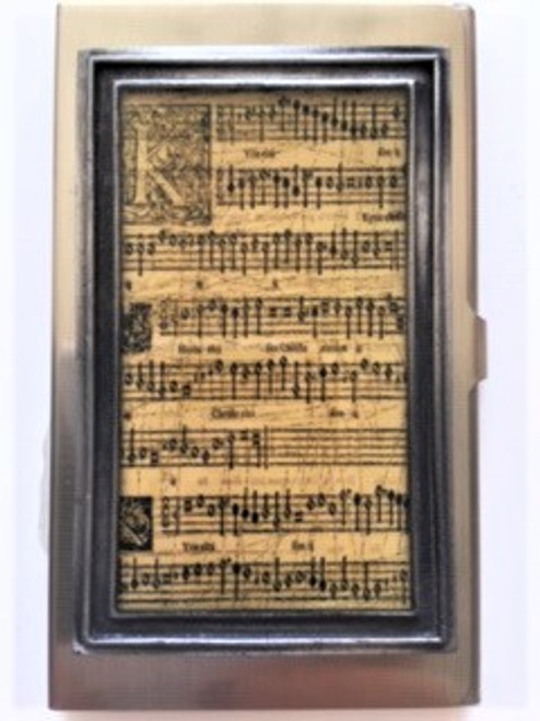 """Bronze colored durable & unique metal case Size:  2.25"""" x 3.75"""" x .31"""" Vintage music notes artwork encased in multi layer hand poured resin for durability Handmade in Los Angeles by KBD Design"""