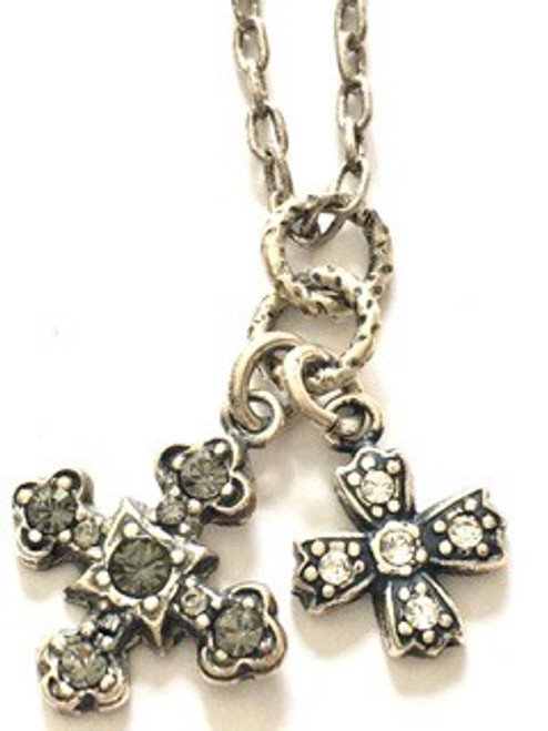 """From the """"old silver"""" collection Sterling silver over a copper base metal Necklace length is 18"""" but can be adjusted to 16"""" using attached jump ring Spring ring fastener Large cross has five black diamond Swarovski crystals; size is .62"""" Small cross has five clear Swarovski crystals; size is .37"""" By La Vie Parisienne"""