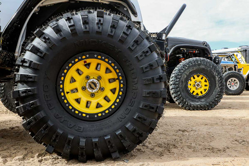 """Close up view of the Mickey Thompson ProX tire on a 17"""" KMC wheel"""