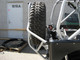 """GenRight's Swing Down Tire Carrier for the Jeep CJ shown with a 40"""" tire"""