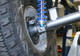 Lower shock mount installs on the back side of the rear axle tube.