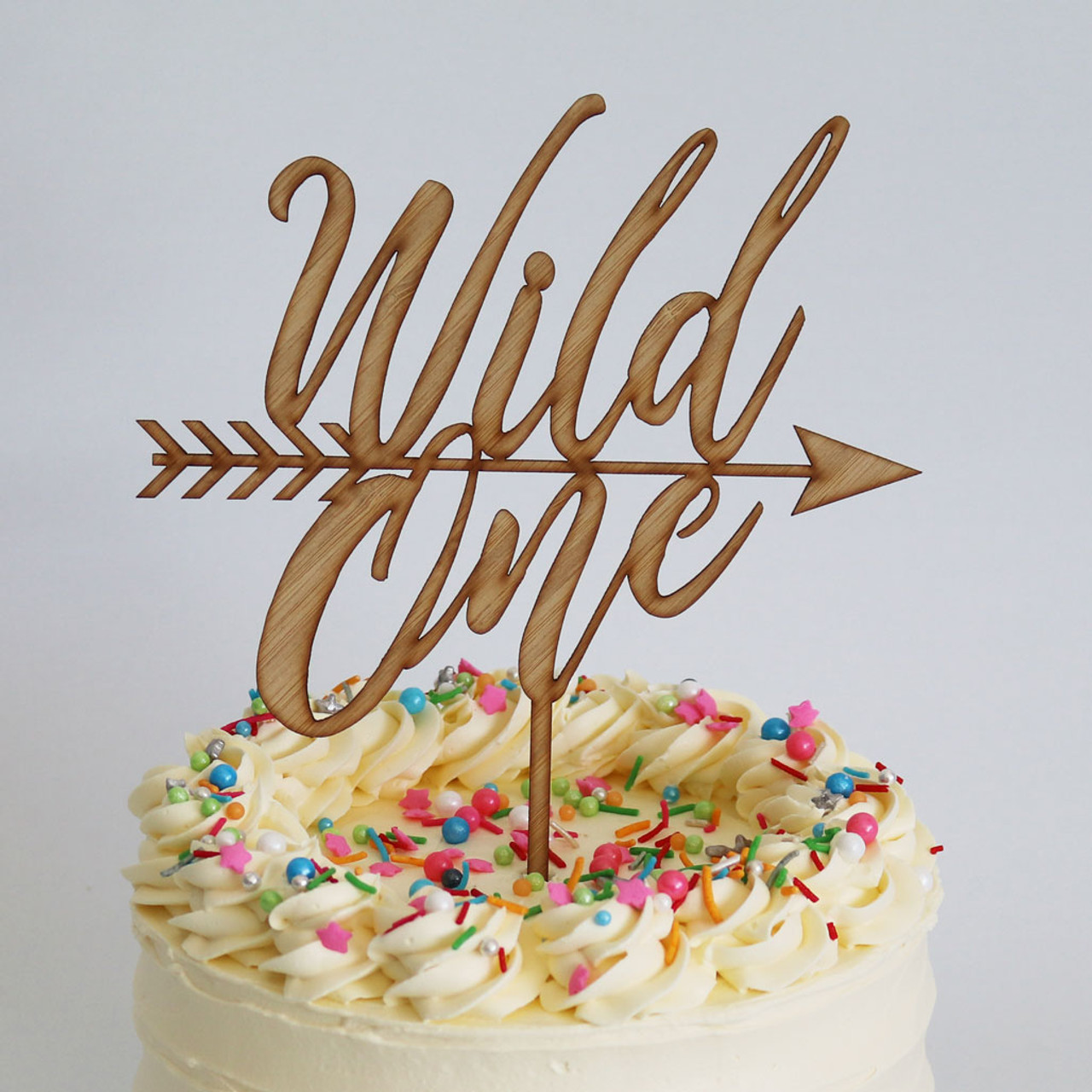 Wild One Bamboo Cake Topper on Cake