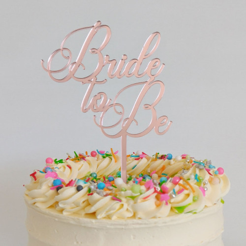 Rose Gold Bride to Be Cake Topper on cake