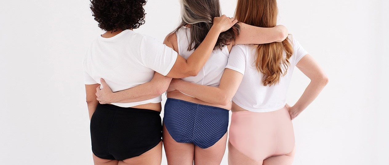 Back shot of threes ladies wearing black, navy, and blush highwaist leakageproof underwear