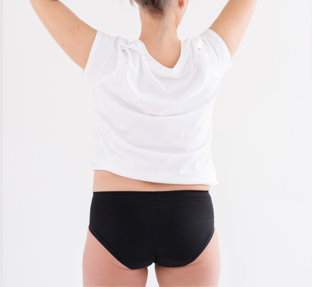 Backshot of lady in hipster leakageproof underwear in a white t-shirt
