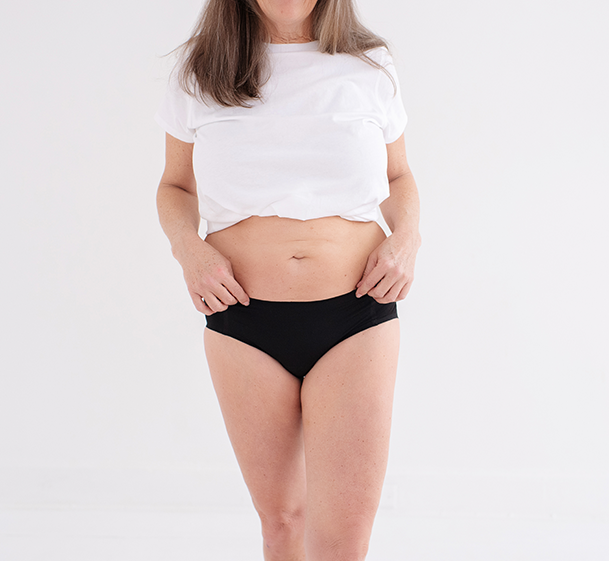 Front side shot of lady in hipster leakageproof underwear in a white t-shirt