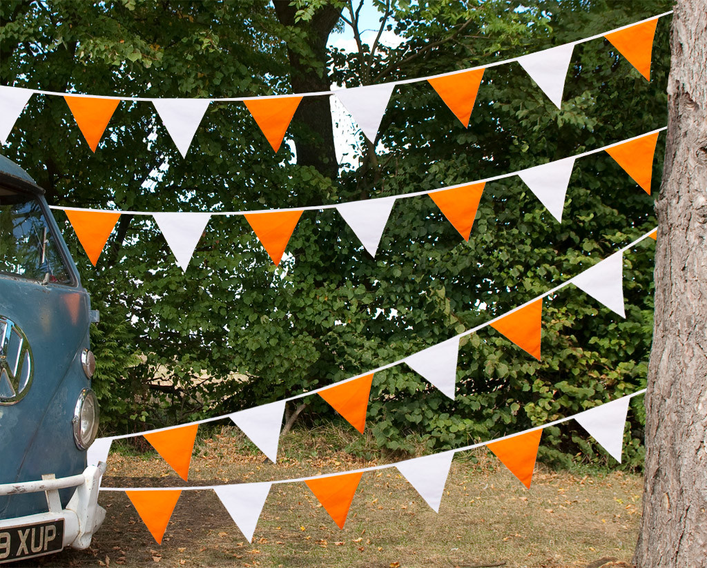 Orange and White Bunting Camper Van