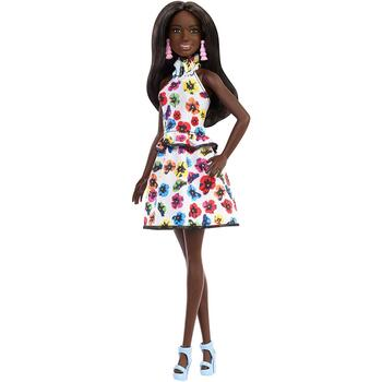 Barbie doll wears a white halter dress with colourful floral print, peplum and ruffles.