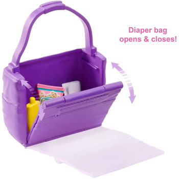 Open the working diaper bag to grab supplies and create a clean space to change baby.