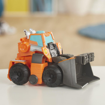 AS SEEN IN THE TRANSFORMERS RESCUE BOTS ACADEMY TV SERIES: Kids can imagine racing to the rescue with this Wedge the Construction-Bot toy, inspired by the Transformers Rescue Bots Academy show.