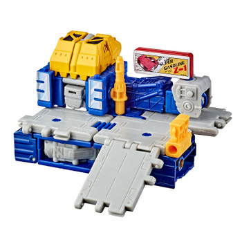 This Greasepit figure can be disassembled and reassembled into a battle station mode inspired by the look of the 1989 Micromaster gas station toy.